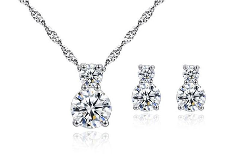 Image of £10 instead of £69 for a brilliance clear crystal pendant and earring set from Genova International Ltd - save 86%