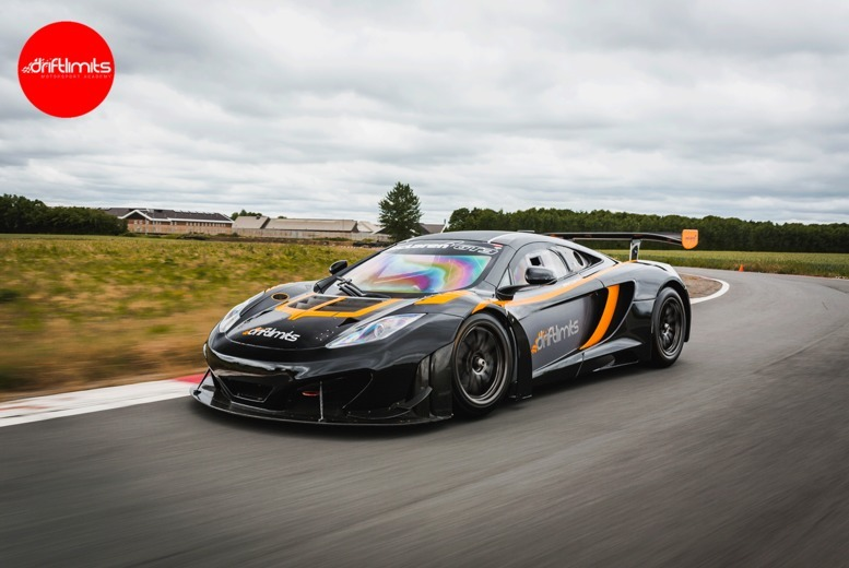 Image of £149 instead of £298 for a 20-lap McLaren v Ferrari Race Car driving experience at Drift Limits, Hemel Hempstead - get the perfect gift and save 50%