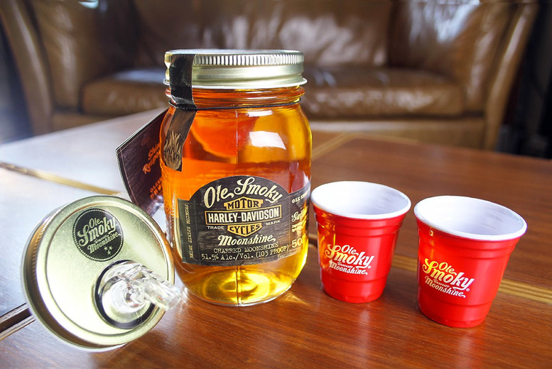 Image of £44 for a 50cl bottle of Ole Smokey Harley Davidson Moonshine with two shot cups and a pour lid