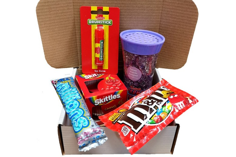 Image of £9.99 for a stocking filler 5 pack hamper from GB Gifts - includes an air freshener, candle, lip balm, and sweeties!