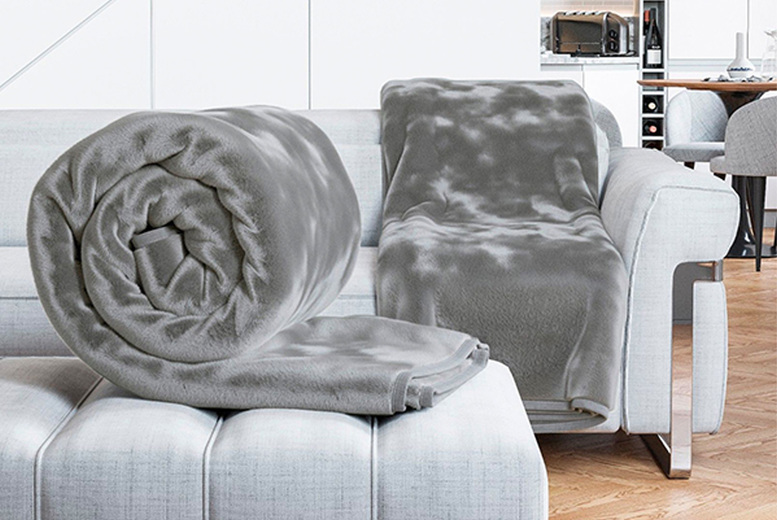 Image of £7.99 instead of £19.99 for a small luxury faux fur throw, £9.99 for a medium or £13.99 for a large in black, blush, fuschia, grey, ivory or mink from Daniel James - save up to 60%