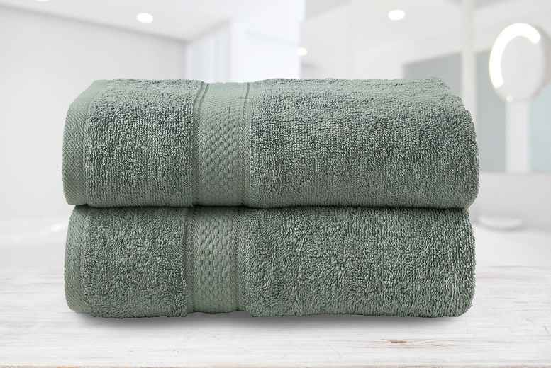 Image of £14.99 for a pair of cotton bath towels in orange, mustard, burgundy, silver, chocolate, duck egg, red, lilac or sunflower yellow from Bubble Bedding