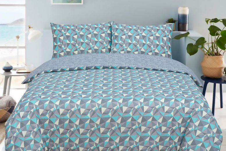 Image of £12 for a single teal and grey geometric reversible duvet set, £14 for a double or £16 for a king size from Bubble Bedding!