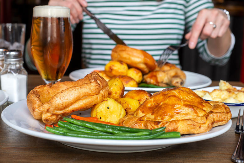 Image of £10 instead of £24.85 for a takeaway Sunday roast for one person with a craft beer at Draft House, £12.50 for eat-in - choose from eight locations and save up to 60%