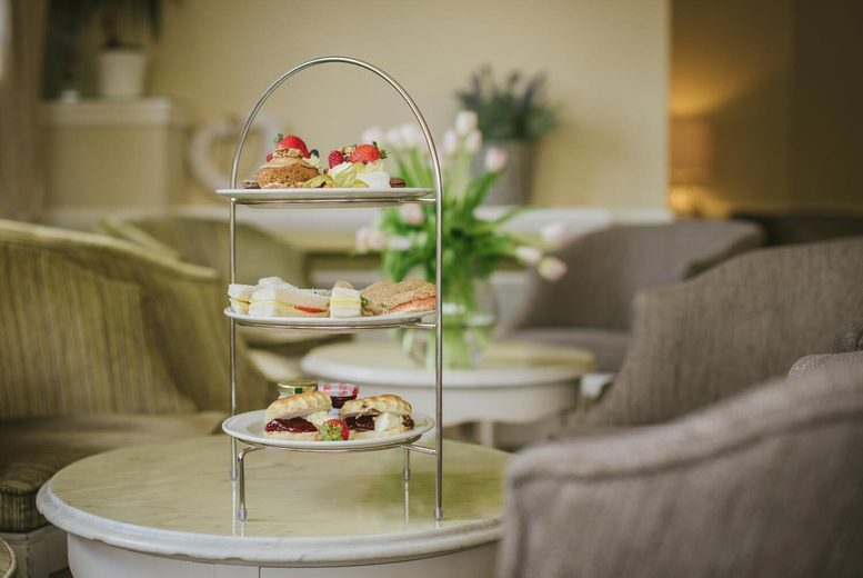 Image of £19.99 for an afternoon tea for two people at Hotel Collingwood, Bournemouth. £24.99 to include a glass of Prosecco each, or £29 for a festive afternoon tea with a glass of Prosecco each