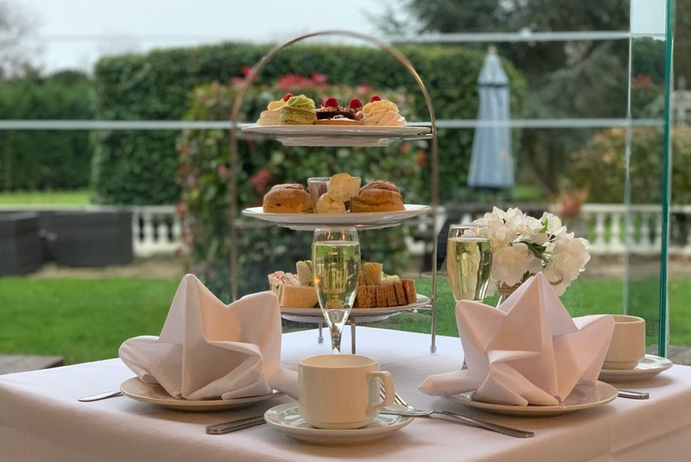 Image of £29 instead of £49.90 for a sparkling afternoon tea for two people at Manor of Groves, Hertfordshire including a glass of Prosecco each - save 42%