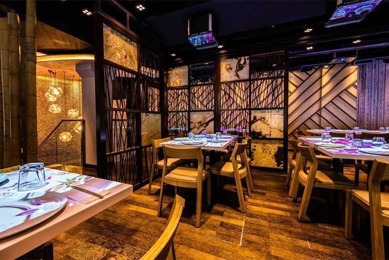 Image of £27.95 instead of up to £107.76 for 'unlimited' sushi and Asian tapas for one person at Inamo. £42 for 'unlimited' sushi and Asian tapas with 'bottomless' wine or beer at Inamo - dine at Soho or Covent Garden and save up to 73%