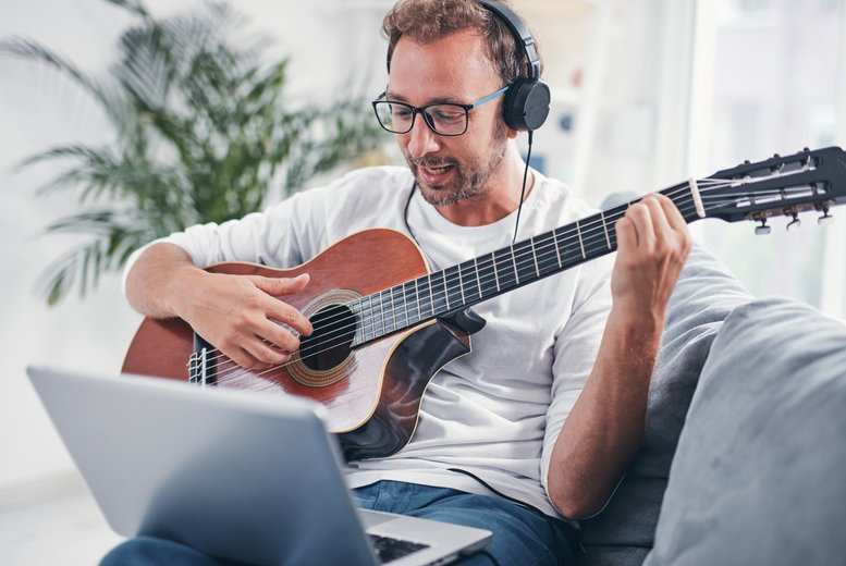 Image of £9 for three live online guitar lessons for beginners with tutor support from Igloo Music