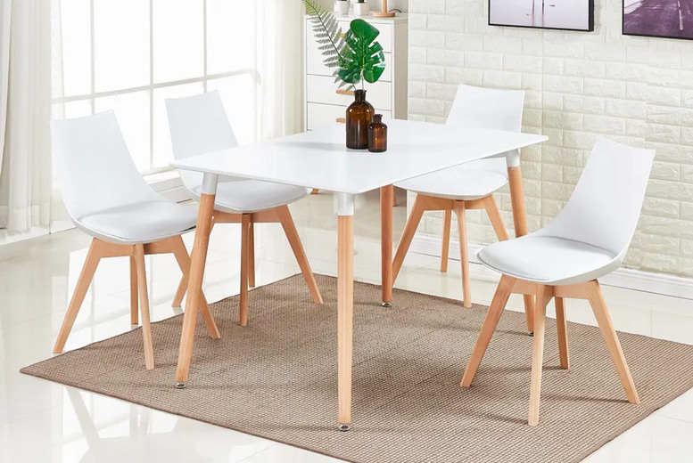 Image of £179 instead of £450 for a white dining table with four chairs in white, grey or black from My Home Furniture - save 60%