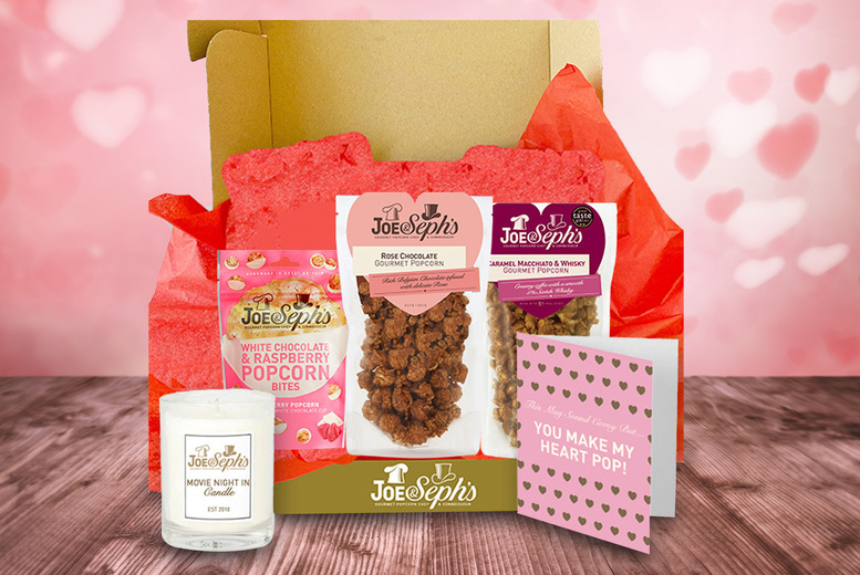 Image of £24.99 for a Valentine's gourmet gift bundle hamper including two sharing bags of popcorn, chocolate popcorn bites, a gift card and a relaxing candle from Joe & Seph