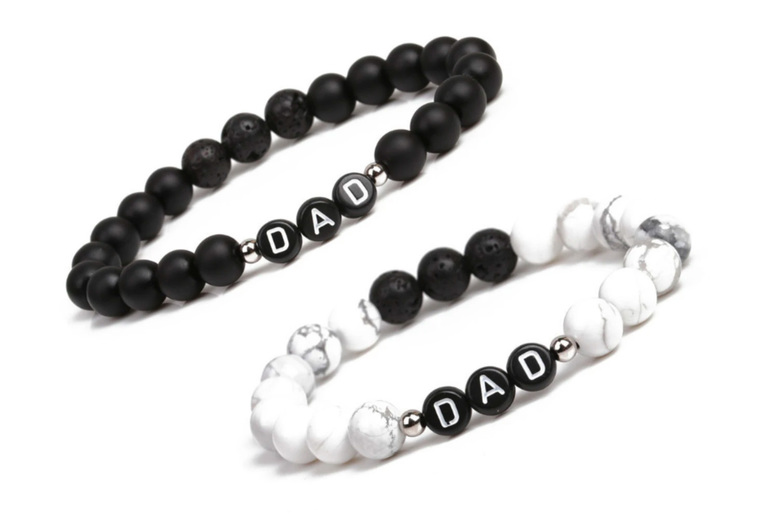 Image of £6.99 instead of £29.99 for a 'DAD' beaded bracelet in black or white My Name Chain saving 77%!