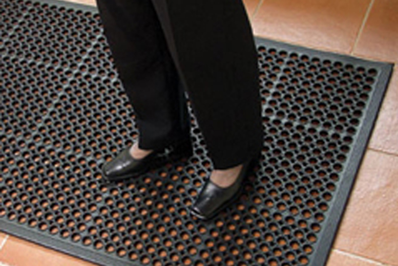 Image of £34.99 instead of £59.99 for a ramped edge mat with drainage holes from Mats World - save 42%