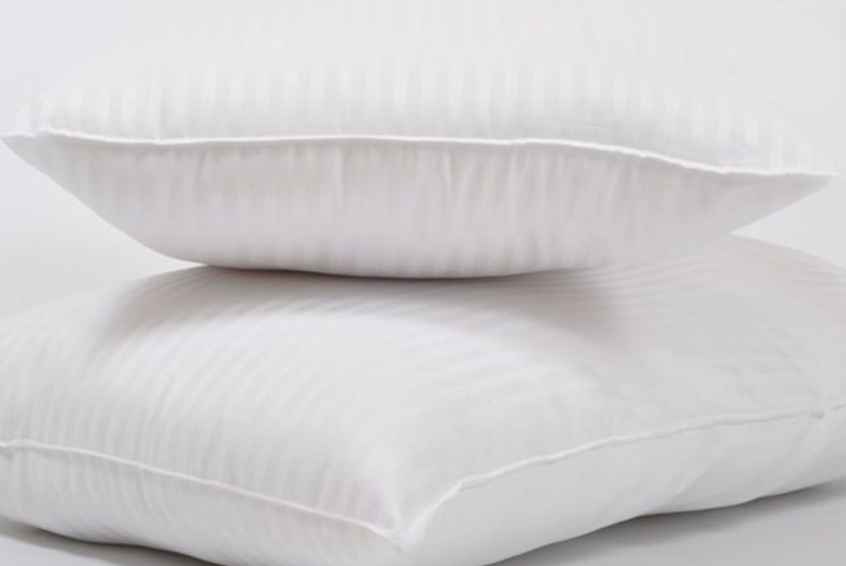 Image of £12.99 instead of £34.95 for two ultra-firm non-allergenic pillows from Love 2 Sleep! - save 62.83