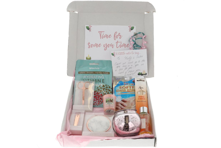 Image of £23.50 instead of £39 for a Spa At Home gift box hamper with a derma face mask, a hand glove mask, reed diffuser, scissors, nail clippers, compact mirror, and a Yankee candle and candle holder from Always Looking Good - save 40%