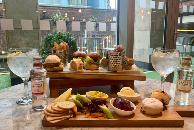 Image of £22 instead of £49 for a rustic afternoon tea on an outdoor terrace for two people with a gin and tonic each at the 4* Holiday Inn Manchester City Centre - save 55%