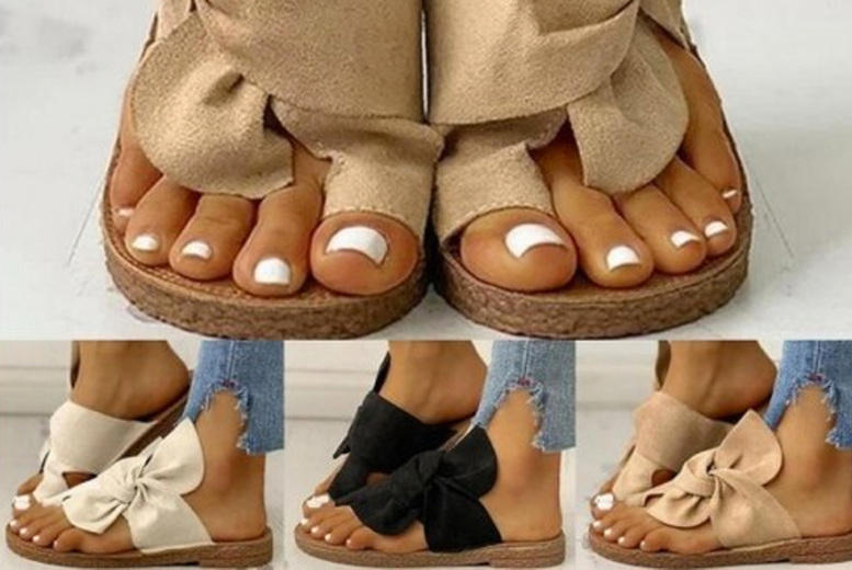 Image of £11.99 instead of £37.99 for a pair of sandals with bows from CN Direct Biz - choose from black, cream or khaki and save 68%