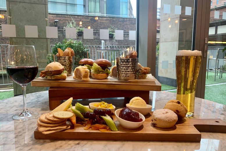 Image of £22 instead of £40 for an outdoor terrace rustic afternoon tea for two people with a glass of wine or beer each at the 4* Holiday Inn Manchester City Centre - save 45%