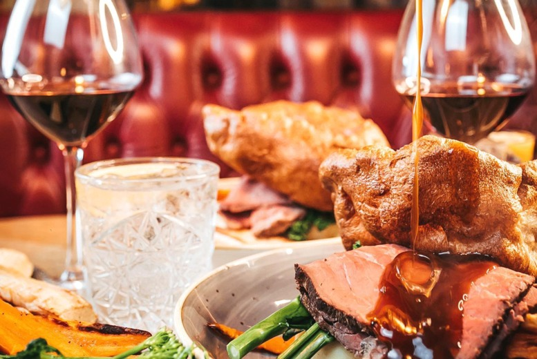 Image of £26 instead of £56.30 for a two-course Sunday lunch for two including a glass of wine each at Impossible, Manchester - save 54%